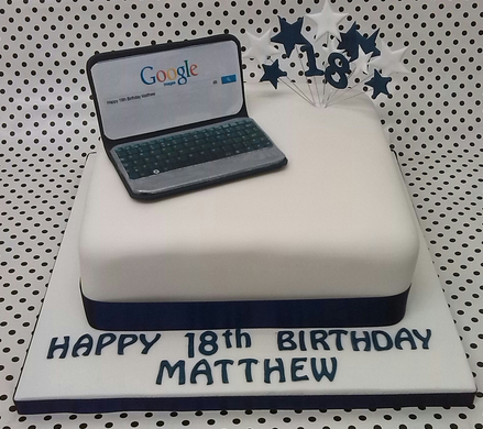 white laptop cake